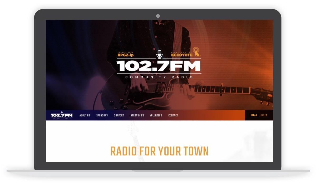 102.7FM desktop homepage screen